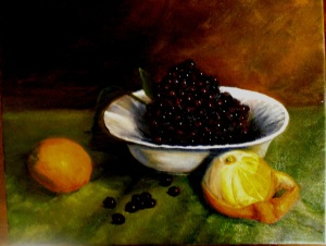 An oil painting study of oranges and grapes on a green cloth