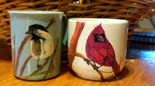 two coffee mugs painted with sharpie markers and baked